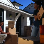 Couple Moving Boxes Between Homes